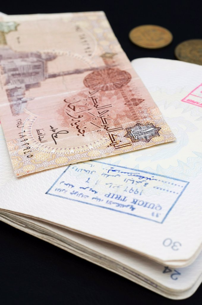 Stock Photo: 1566-1089352 Passport and Egyptian Banknote