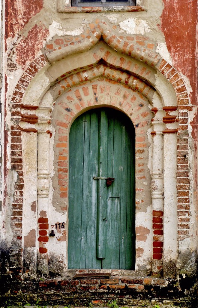 Stock Photo: 1566-1089892 Russia, Goritzy, Monastery of the Resurrection, founded by Saint Cyril in 1397, Door showing some restoration work Vologda Oblast