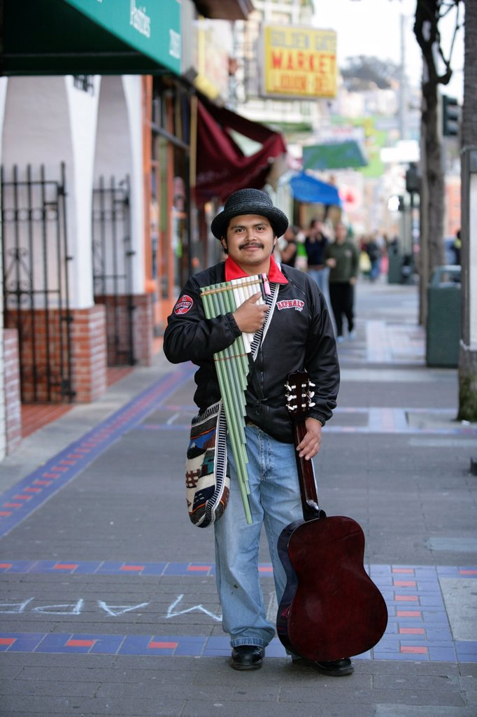 Portrait of a hispanic musician on Mission Street, San Francisco, California, USA  Mission District is one of the most colorful neighborhoods of San Francisco with a vibrant arts community and adorned with multicultural murals : Stock Photo