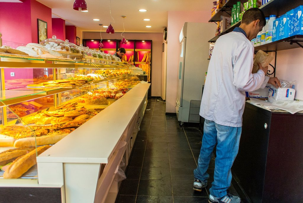 Paris, France, Clerk in Arab French Bakery Shop, Boulangerie, in Belleville Chinatown District : Stock Photo