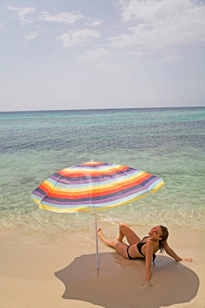 Stock Photo: 1566-1097922 Woman sunbathing in a beach in Formetera, Balearic Island, Spain