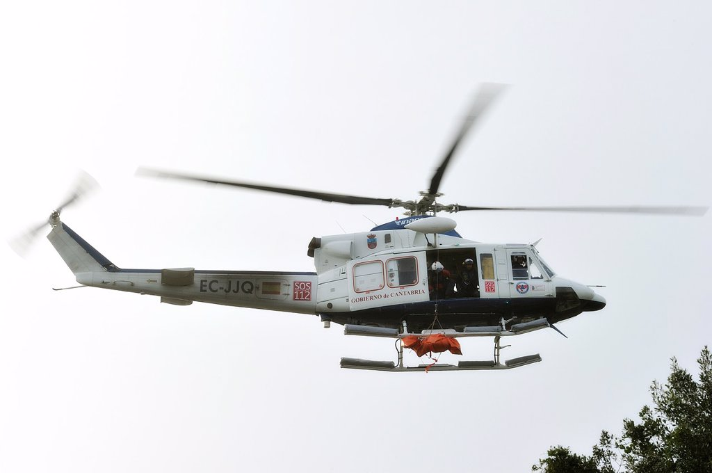 Stock Photo: 1566-1098035 Rescue helicopter transporting a body
