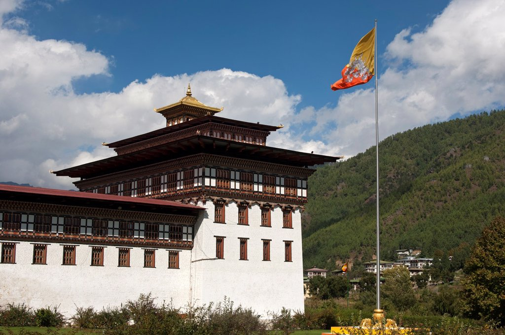 Stock Photo: 1566-1098772 The Bhutanese national flag flutters at the seat of government Thimphu Dzong or Trashichhoe Dzong, Thimphu, Bhutan