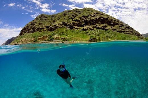 Split image of snorkeler and costal hill, Makua Beach, Oahu, Hawaii, USA. : Stock Photo