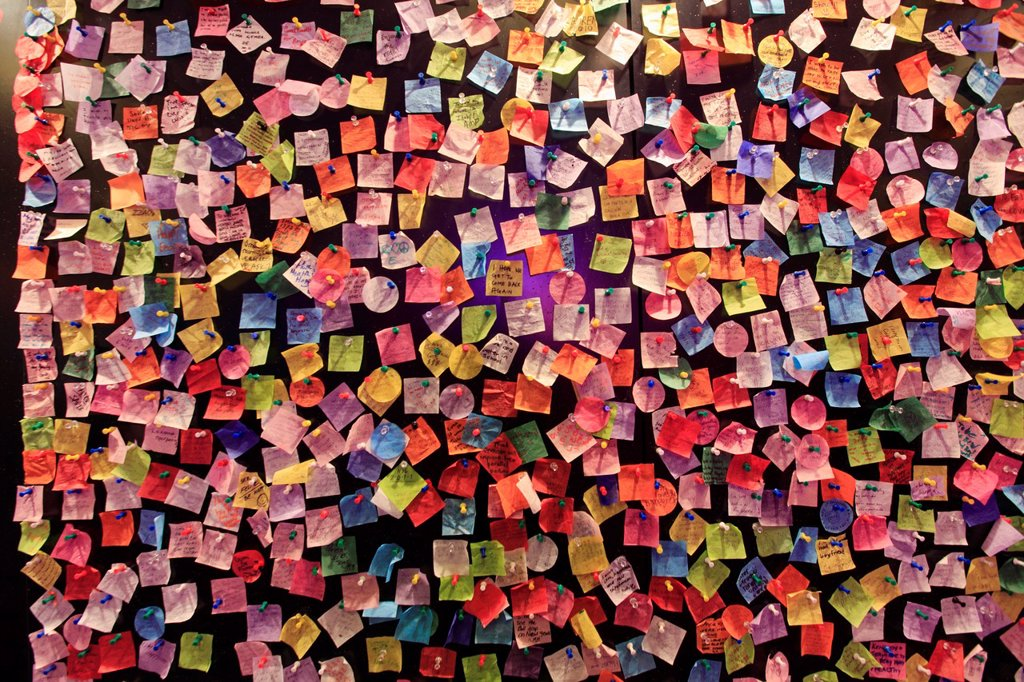 Stock Photo: 1566-1102006 Colourful wish notes left by visitors on the wall of Times Square Visitor Center  Manhattan  New York City  USA.