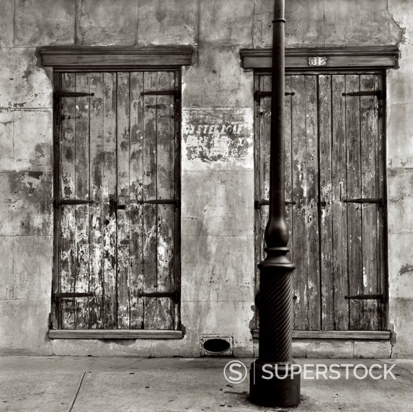 Lamp post and shuttered windows, Dauphine street, French Quarter, New Orleans, Louisiana, United States : Stock Photo