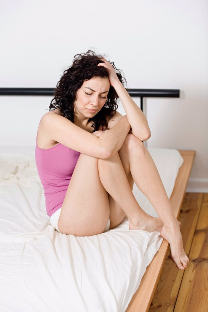 Woman with headache in bed : Stock Photo