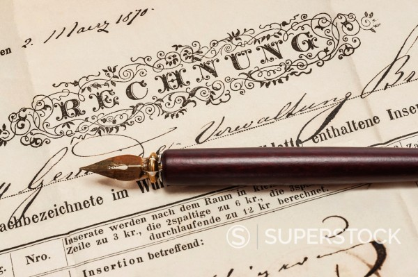 Stock Photo: 1566-1106666 Detail photo of a old German invoice from the year 1870, a fountain pen is alongside