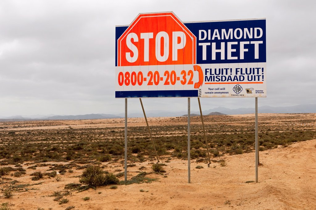 Warning sign of the Trans Hex Group Ltd  diamond mining company against the theft of diamonds, Northern Cape Province, South Africa : Stock Photo