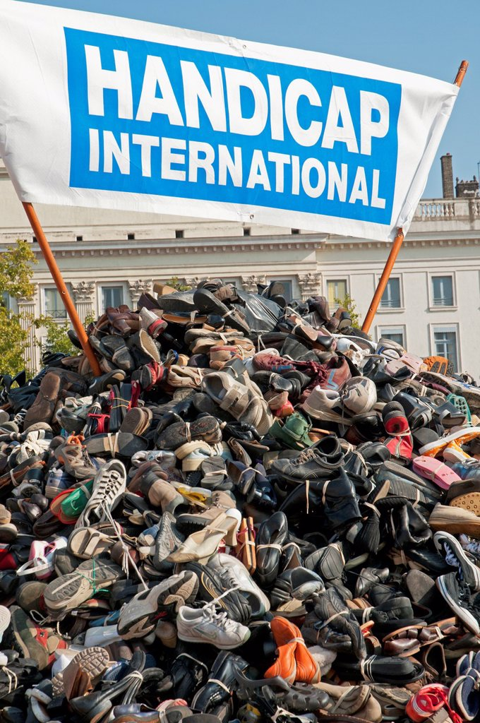 Stock Photo: 1566-1108656 Anti-personnel mines manifestacion in Lyon, people brought pairs of shoes connected with shoelaces to symbolize that we need both legs, Rhône-Alpes, France