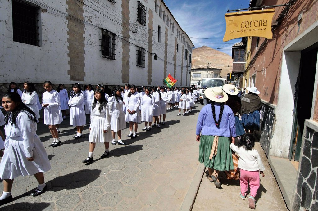 School parade. Potosí, city and the capital of the department of Potosí in Bolivia. It is one of the highest cities in the world by elevation at a nominal 4,090 metres. Bolivia. : Stock Photo