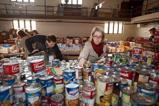 Pontiac, Michigan - Volunteers sort donated food which will be distributed to low-income families for Thanksgiving  The annual food distribution is organized by Lighthouse of Oakland County, a social services agency : Stock Photo