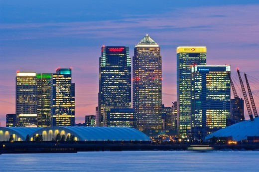 canary wharf skyline shot from across the river thames at night : Stock Photo