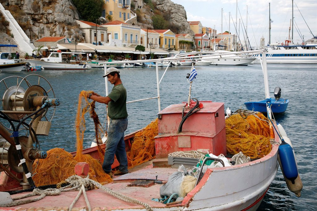 Fisherman at the harbour, Symi, Greece : Stock Photo
