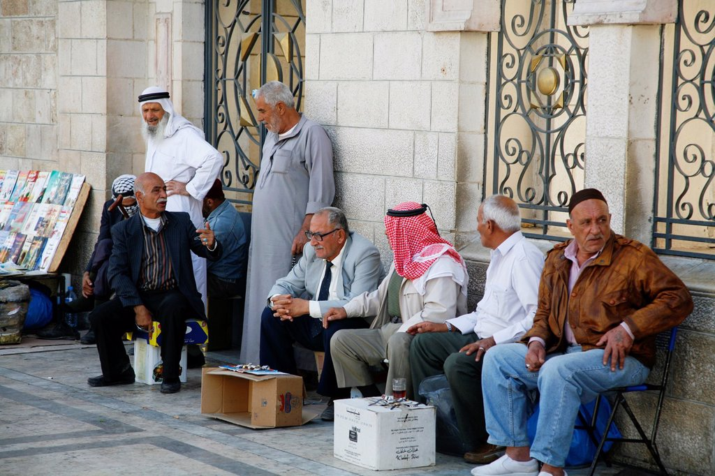 Men outside the Al Husseiny mosque in downtown Amman, Jordan : Stock Photo