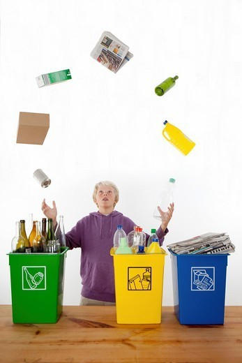 Teenager juggling recycling domestic waste : Stock Photo