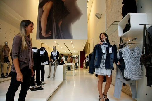 Woman looking at clothes in a fashion boutique on Rua Oscar Freire street, Jardins area, Sao Paulo, Brazil : Stock Photo