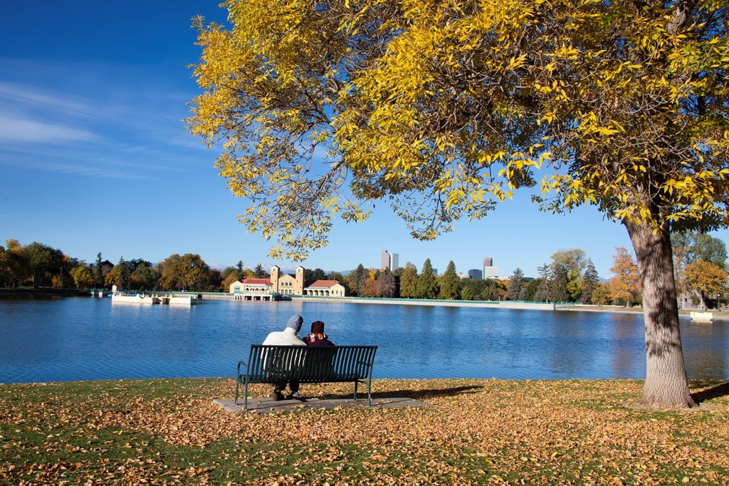 Stock Photo: 1566-1117007 Couple resting and boathouse in City Park, Denver, Colorado, USA