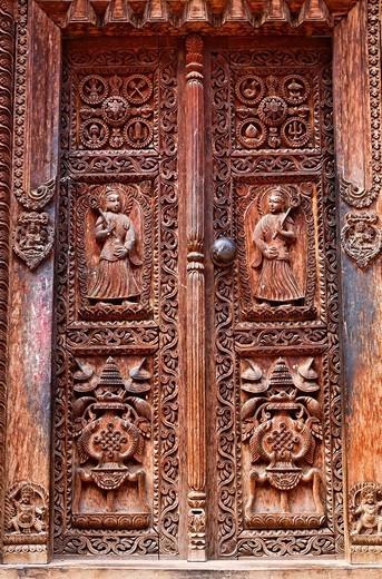 Carved wooden door, Bhaktapur, Kathmandu Valley, Nepal : Stock Photo