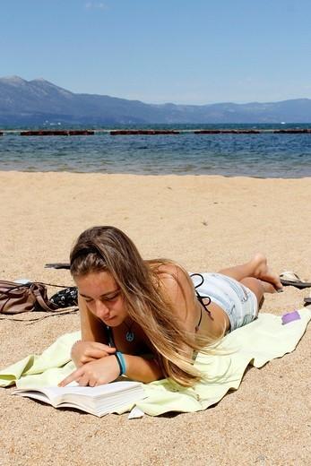 Stock Photo: 1566-1118876 Sunbathing girl on South Lake Tahoe, California, USA