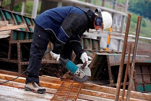 Stock Photo: 1566-1119037 Cutting rebar, grinder, construction site, Eskoriatza, Gipuzkoa, Euskadi, Spain