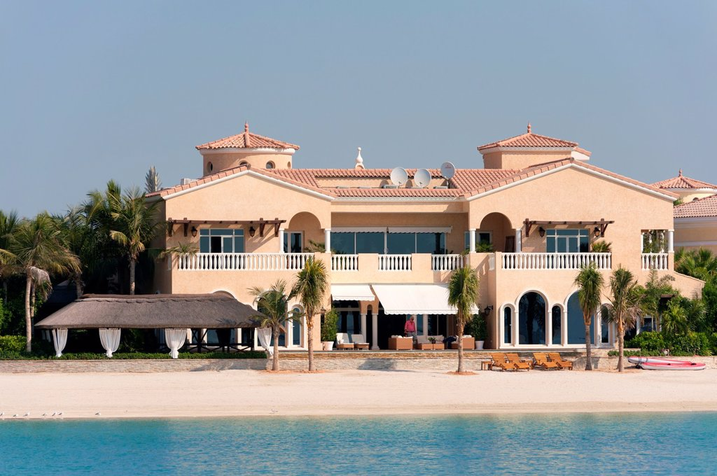 Villa residence located on frond of Palm Jumeirah in Dubai in United Arab Emirates : Stock Photo