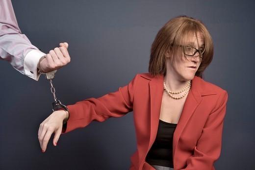 Woman handcuffed to her husband´s wrist : Stock Photo
