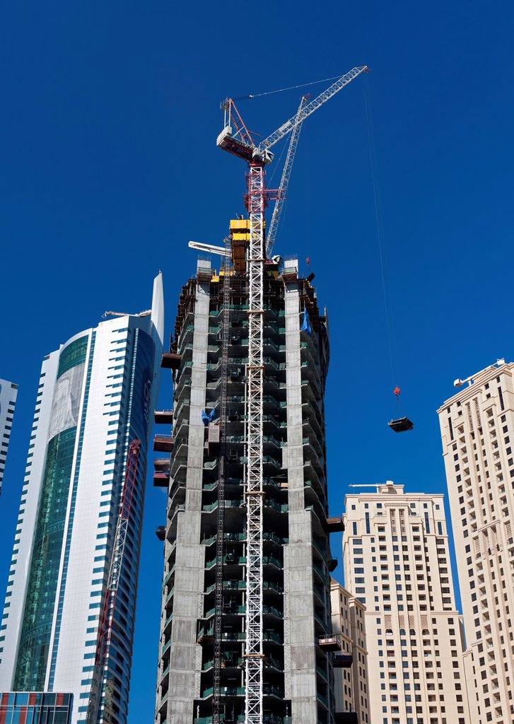 Stock Photo: 1566-1123511 View of construction of high-rise modern building towers in Marina at New Dubai in United Arab Emirates