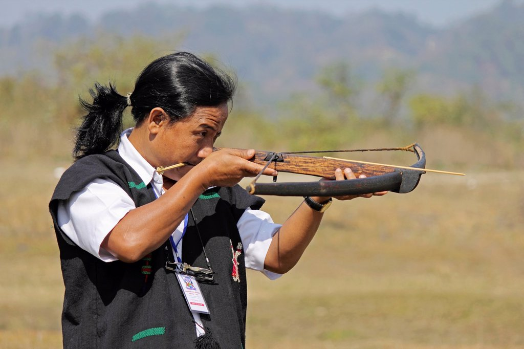 Stock Photo: 1566-1125029 Tribe, man perform Traditional Crossbow Competition at Namdapha Eco Cultural Festival, Miao, Arunachal Pradesh, India
