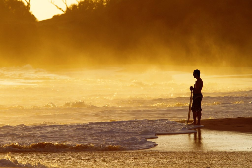 Stock Photo: 1566-1125482 Skimboarder at sunset at Makena, Maui, Hawaii