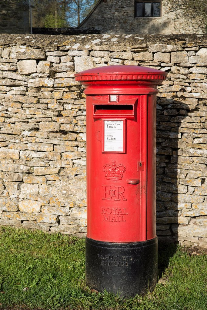 Stock Photo: 1566-1125520 Red postbox by a drystone wall Tackley Oxfordshire England UK