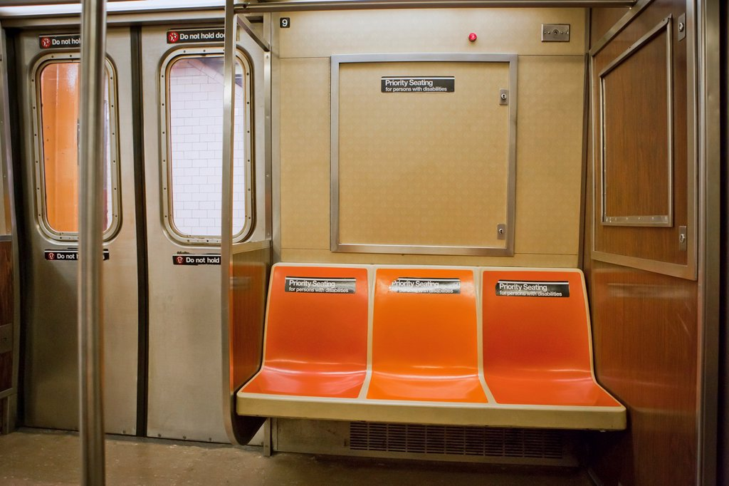 Empty Priority Seating in New York City Subway cart with doors closed : Stock Photo