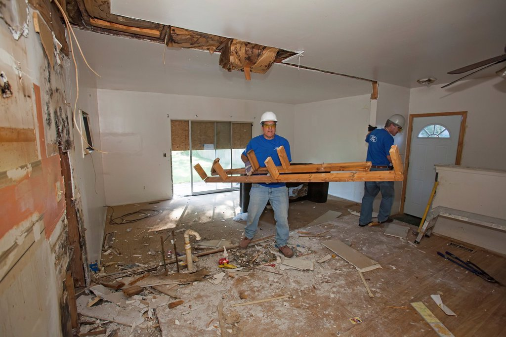 Stock Photo: 1566-1131305 Ypsilanti, Michigan - Volunteers from Ford Motor Co  renovate a foreclosed house for Habitat for Humanity