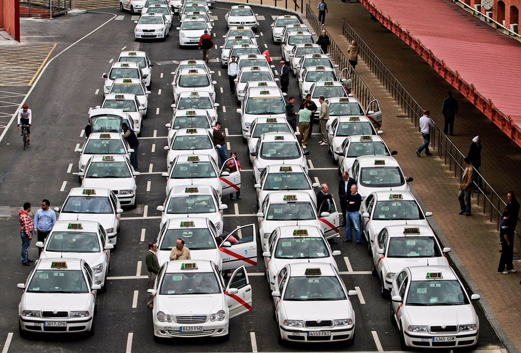 Stock Photo: 1566-1131605 Taxi cabs queing for customers at Atocha stations, Madrid, Spain