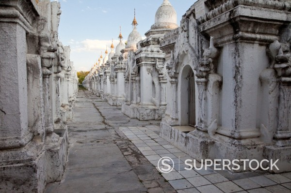 Stock Photo: 1566-1131999 Myanmar, Burma, Mandalay  Kuthodaw Temple, around which 729 marble slabs display the 15 books of the Tripitaka, each page housed in a separate stupa  Construction began 1857