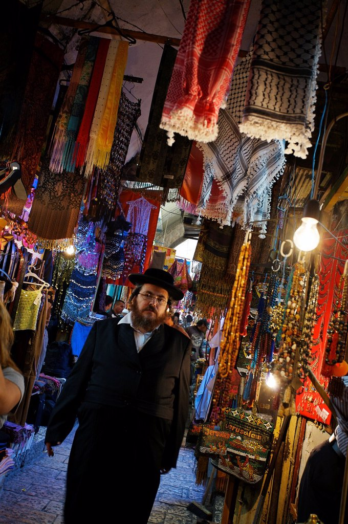 Stock Photo: 1566-1132310 Orthodox Jew, Souk Arabic market in the Palestinian area of Jerusalem  Israel.