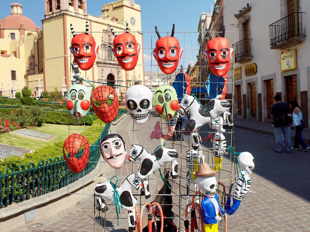 Stock Photo: 1566-1133096 Mexican masks of good and evil outside the main church