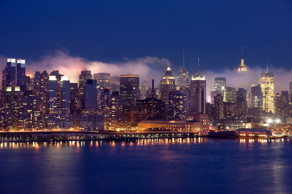Stock Photo: 1566-1134802 MIST BETWEEN BUILDINGS MIDTOWN SKYLINE HUDSON RIVER MANHATTAN NEW YORK USA