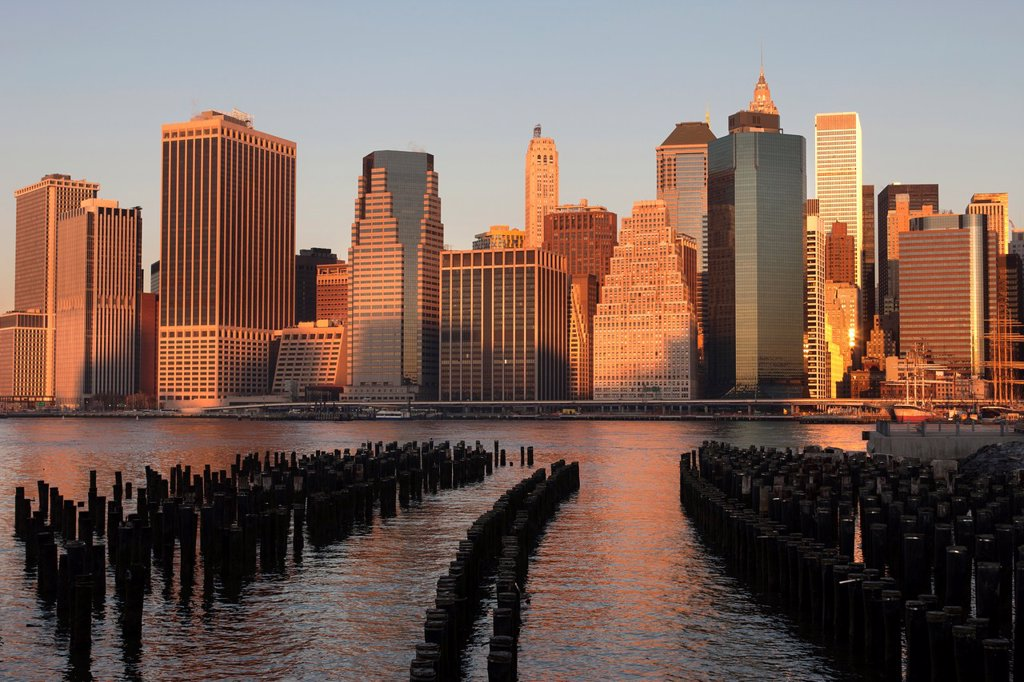 Stock Photo: 1566-1135575 WOODEN PILINGS DOWNTOWN SKYLINE EAST RIVER MANHATTAN NEW YORK CITY USA