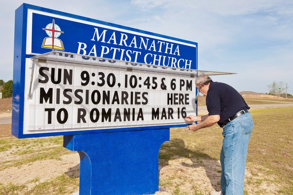 Stock Photo: 1566-1135898 Member changing message on sign outside Maranatha Baptist Church in Ocala, Florida