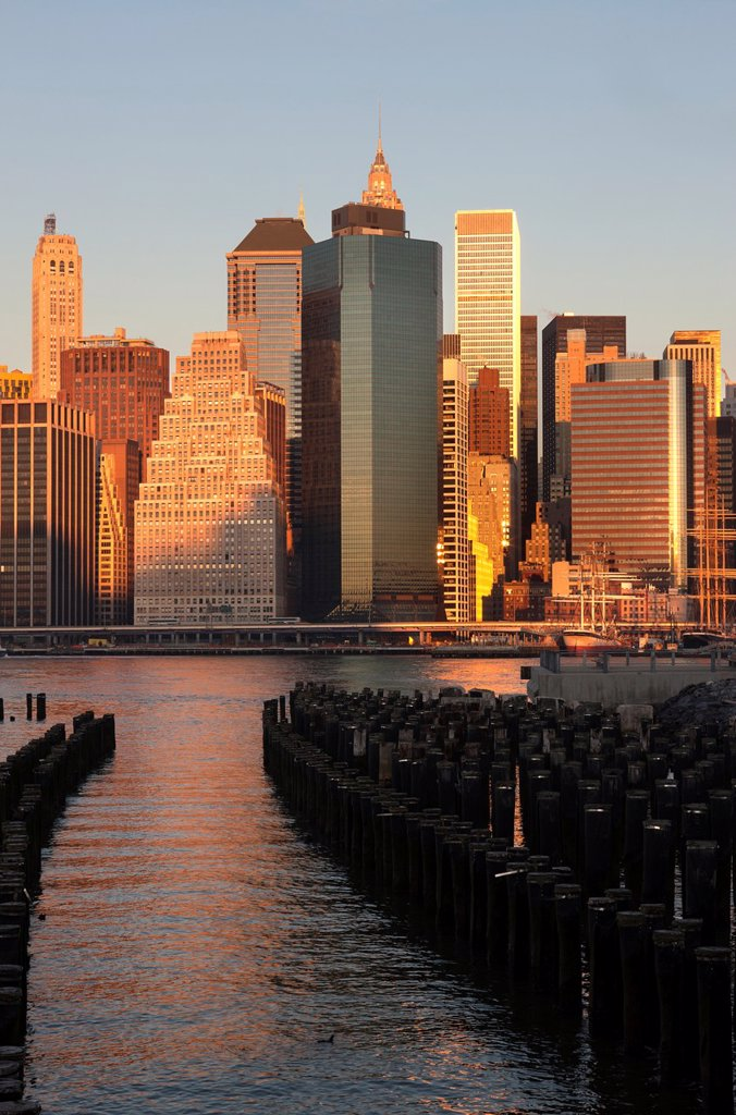 Stock Photo: 1566-1136577 WOODEN PILINGS DOWNTOWN SKYLINE EAST RIVER MANHATTAN NEW YORK CITY USA