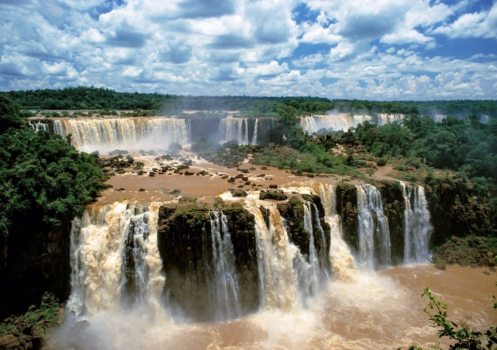 Stock Photo: 1566-1137371 The Iguassu Falls  Brazil are waterfalls of the Iguazu River on the border of Brazilian State Paraná and Argentine Province Misiones  The falls divide the river into the upper and lower Iguazu  The Iguazu River originates near the city of Curitiba  It flo. The Iguassu Falls  Brazil are waterfalls of the Iguazu River on the border of Brazilian State Paraná and Argentine Province Misiones  The falls divide the river into the upper and lower Iguazu  The Iguazu River originates near the city of Curi