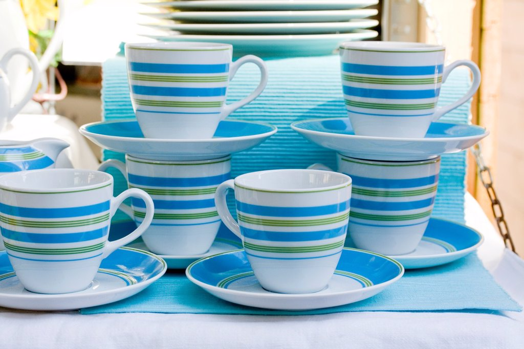 Stock Photo: 1566-1138416 Handcrafted pottery with striped design in public market  Plates, bowls, saucers and assorted pottery by potter in public market