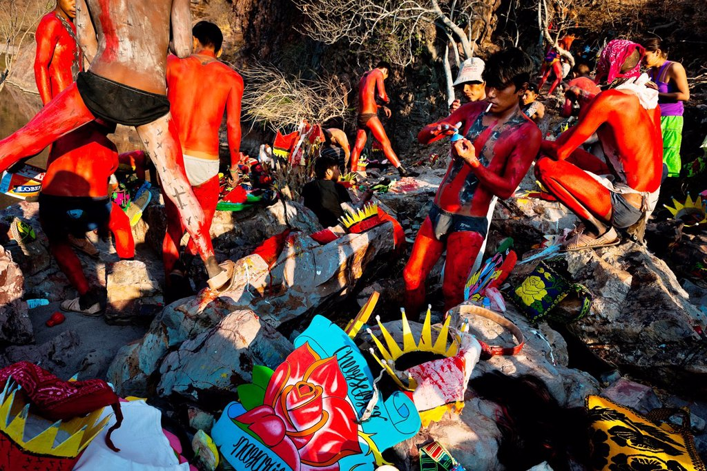 "Stock Photo: 1566-1139830 Cora Indian boys, painting each other their bodies in red color, prepare themselves for the spiritual celebration of Semana Santa Holy Week in Jesús María, Nayarit, Mexico, 22 April 2011  The annual week-long Easter festivity called ""La Judea"", performed. Cora Indian boys, painting each other their bodies in red color, prepare themselves for the spiritual celebration of Semana Santa Holy Week in Jesús María, Nayarit, Mexico, 22 April 2011  The annual week-long Easter festivity called ""La Judea"","