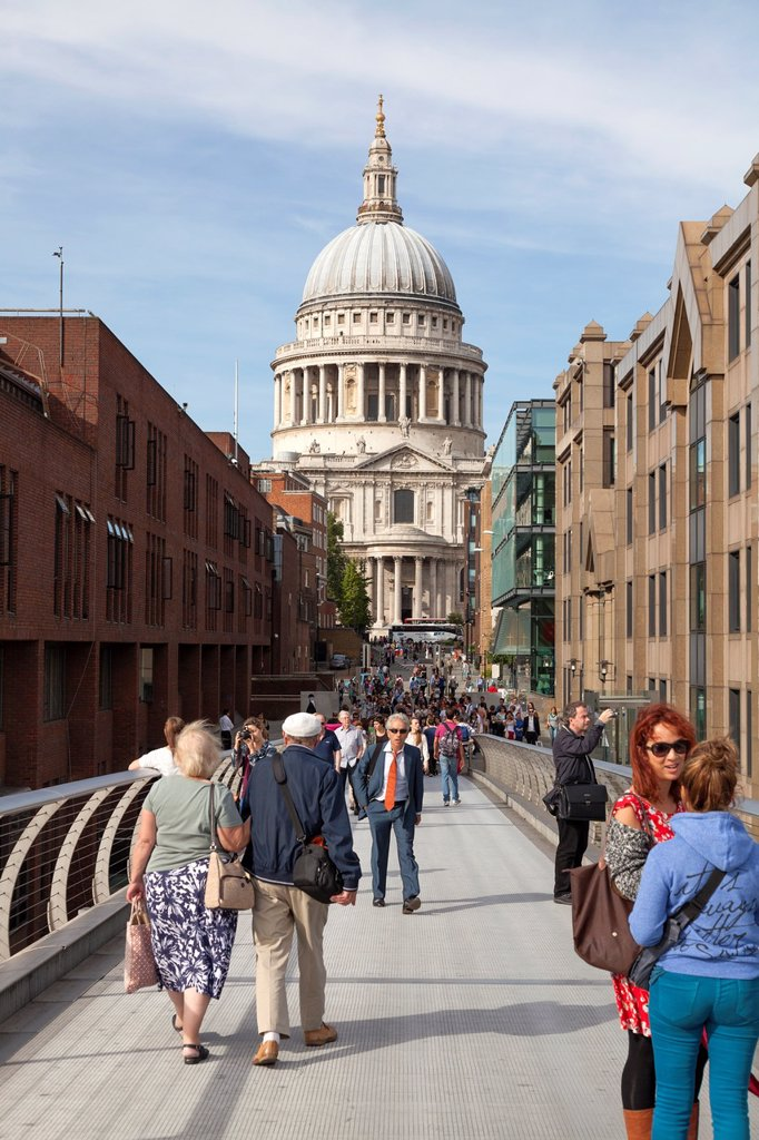 Tourists on the Millennium Bridge and South Facade of Saint Pauls and the dome : Stock Photo