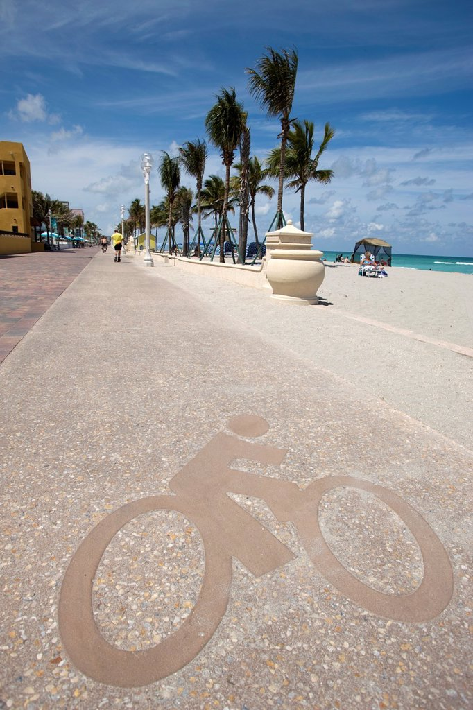 Stock Photo: 1566-1141193 BICYCLE SIGN BIKE PATH ON BEACHFRONT PROMENADE HOLLYWOOD BEACH FLORIDA USA