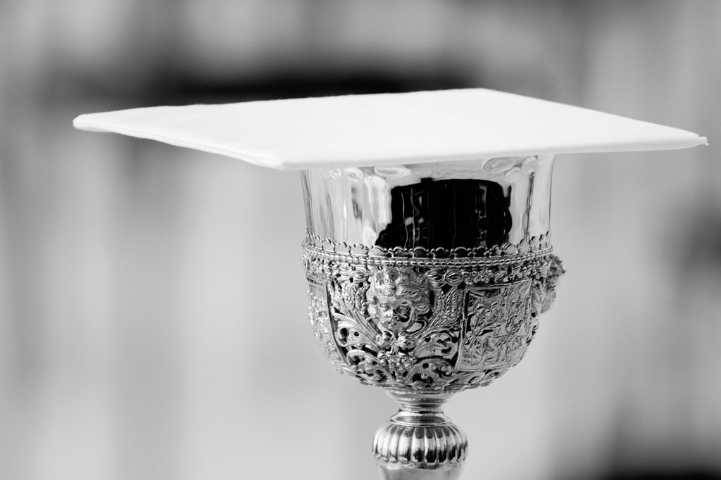 Stock Photo: 1566-1142165 A golden chalice for the Holy Communion seen on the table before the open-air mass served by the Pope Benedict XVI in Stara Boleslav, one of the main pilgrimage site of the Czech Republic, September 28, 2009