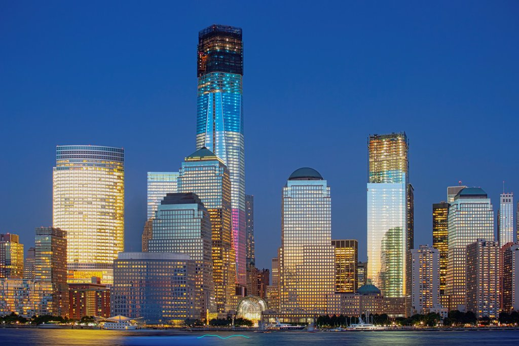 One World Trade Center under construction is illuminated in Red, White and Blue, New York, USA : Stock Photo