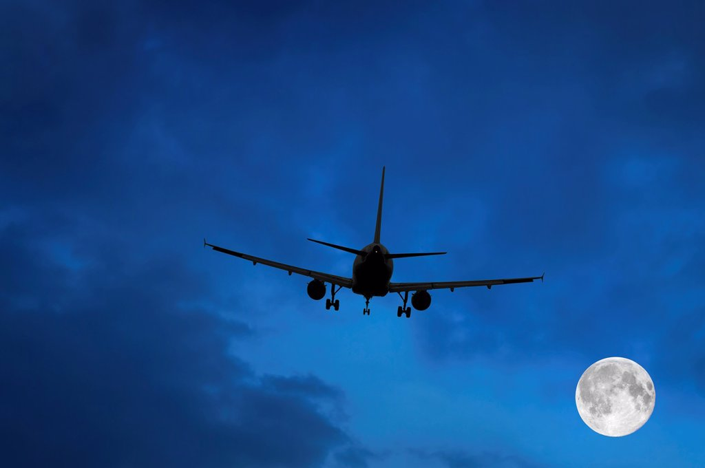 Stock Photo: 1566-1147619 Airplane and Moon in Blue Sky