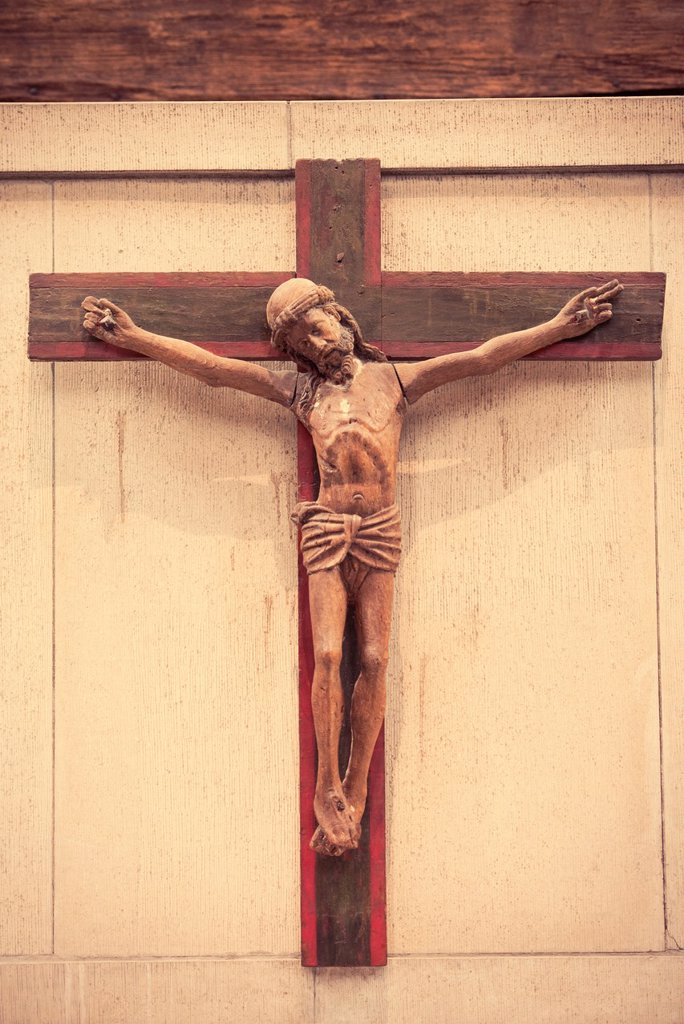 Jesus on the cross, sculpture made in wood : Stock Photo